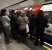Travellers queue as the doors close on a packed rush hour tube train in central London